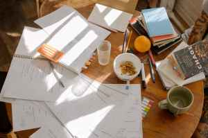scattered mess on a chaotic desk.