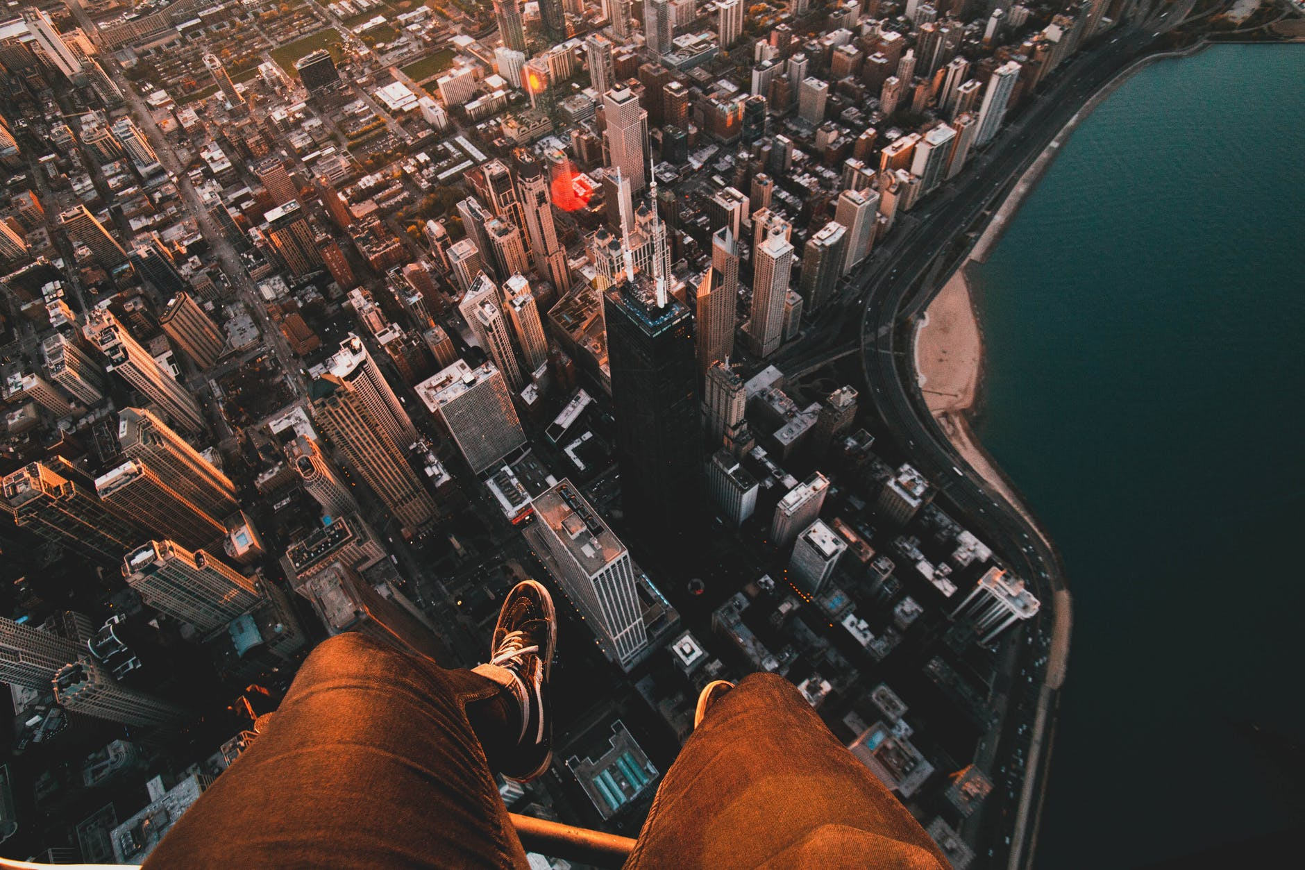hovering over a city looking down past your feet.