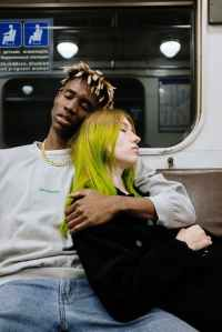 A couple together on the subway